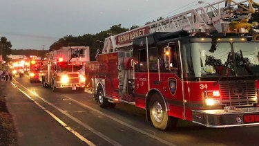 Multiple fire trucks from surrounding communities arrive in Lawrence, Massachusetts.