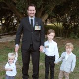 Veteran Carl Hilton marks Anzac Day with Theodore, 1, Hugh, 7, and Richie, 3, outside their Coorparoo home.
