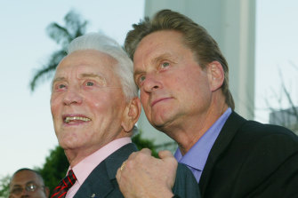 Actor Kirk Douglas poses with his son Michael Douglas at the Los Angeles premiere of their film It Runs in the Family in 2003.