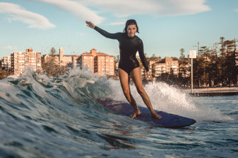 Lucy Small surfing in Manly in May last year.