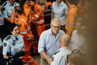 Prime Minister Scott Morrison, pictured with SES workers during the NSW floods, says the new national agency will help communities rebuild and strengthen their ability to deal with future disasters.