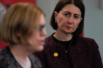 NSW Premier Gladys Berejiklian listens as Chief Health Officer Kerry Chant provides an update on COVID-19 on Friday.