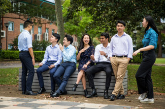 The seven James Ruse students who received an ATAR of 99.95, from left to right: Winston Huang (standing), Eric Huang; Anthony Hwang; Sariena Ye; Dineth Fernando; Alexander Van Phan; Grace Li.