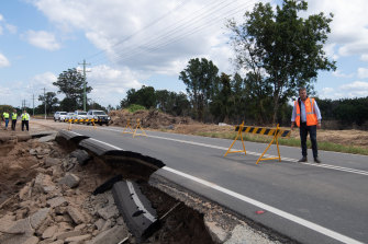 Transport Minister Andrew Constance inspects a collapsed section of Freemans Reach Road just north of Windsor in Sydney's north-west.