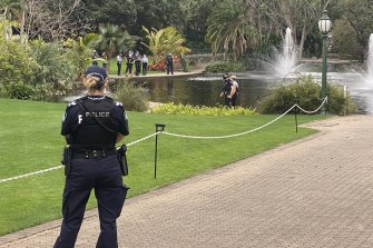 Police at the Brisbane Botanic Gardens, where the body was found in a pond.
