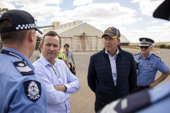 Premier Mark McGowan and Emergency Services Minister Reece Whitby touring cyclone-devastated Kalbarri on Tuesday.