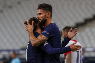 Olivier Giroud celebrates with Antoine Griezmann after scoring in France's win over Croatia, the 4-2 scoreline a repeat of the 2018 World Cup final.