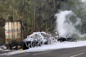 Two road-side workers were injured in a fiery truck crash on the NSW Central Coast.