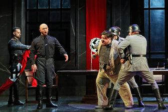 Marco Vratogna as Scarpia and Diego Torre as Tosca's lover, Cavaradossi in a  torture scene in Opera Australia's 'Tosca'.