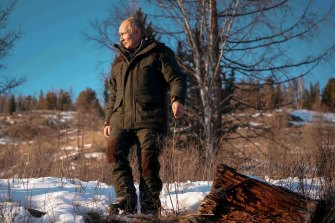Russian President Vladimir Putin poses for photos on a Siberian holiday, March 2021