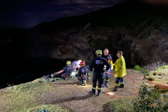 Dozens of rescuers spent hours bringing the pair to safety.