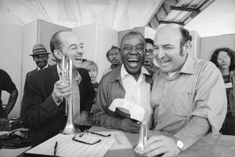 George Wein, right, with the trumpeter Bobby Hackett and Louis Armstrong at the Newport Jazz Festival in 1970.