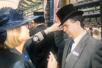 Champion horse trainer Gai Waterhouse adjusts V'landys' top hat at Royal Ascot in England.