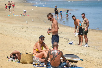 People relax at St Kilda beach during COVID-19 lockdown on Tuesday.