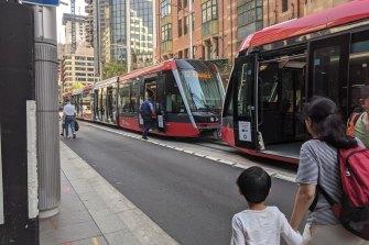 NSW Police board a tram stalled on Sydney's George Street.