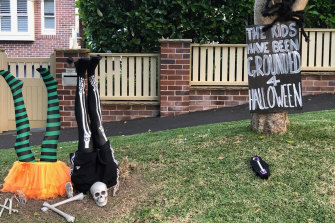 """Halloween decorations by the Powell family of Roseville. The sign reads: """"The kids have been grounded this Halloween."""