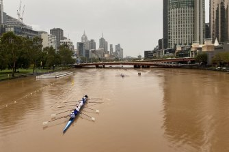 The Yarra River turns a deeper shade of orange-brown after dusty rain fell over Melbourne.