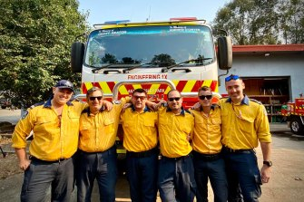 The Horsley Park RFS shared a group photo on their Facebook page ahead of possible catastrophic bushfire conditions on Saturday.
