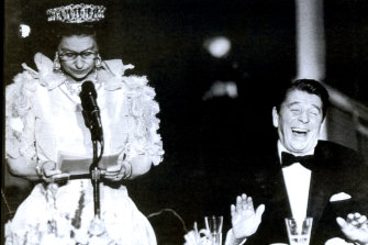 """President Reagan cracks up at a deadpan joke by the Queen about California's """"abominable weather"""" in 1983."""