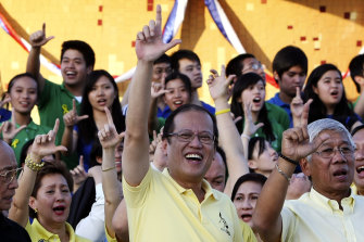 Benigno Aquino, centre, announced his presidential campaign in 2009 by saying he was answering the call of the people to continue his mother's legacy. She had died just weeks earlier of colon cancer.