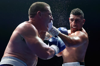 Huni gets a hit on Paul Gallen during his win over the former league star earlier this month.