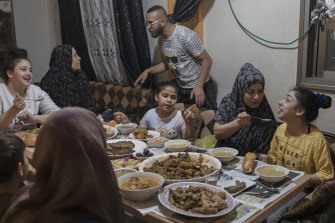 The Rajabi family shares an Iftar meal, breaking the day's Ramadan fast, on May 9.