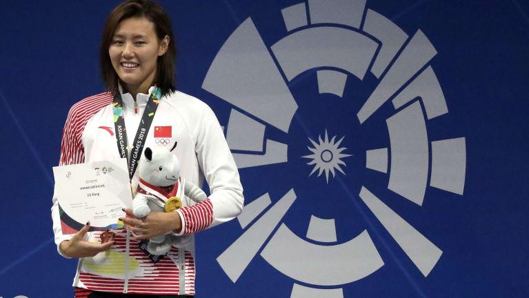 World beater: Liu Xiang after receiving her gold medal.