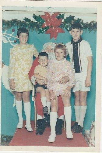 From left, siblings Peta, Dom, Lisa and Steve with Santa at Wollongong DJs in 1966.