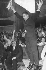 Melbourne coach Norm Smith leaps with joy after Melbourne wins the 1964 grand final.
