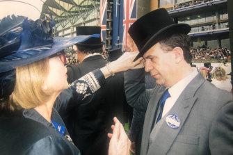 Champion horse trainer Gai Waterhouse adjusts V'landys' top hat at Royal Ascot in England.