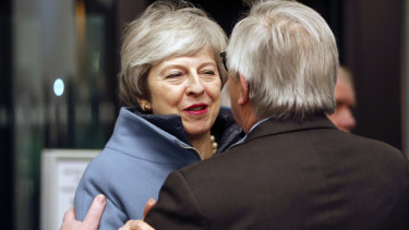 Theresa May and European Commission President Jean-Claude Juncker.