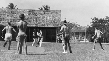 Game on: Australian diggers play on an improvised wicket in Malaya in 1941.