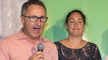 Standing with candidate Alex Bhathal, Greens leader Richard Di Natale concedes defeat in Batman last month.