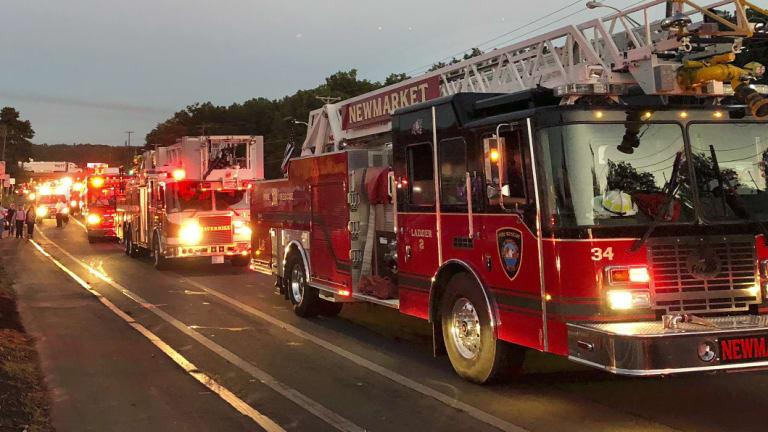 Multiple fire trucks from surrounding communities arrive in Lawrence, Massachusetts.