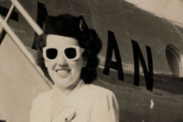 Off to work: freshly-minted Qantas hostess Patricia Burke arrives for work in summer uniform, 1948.