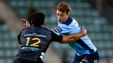 Ramm is tackled during the Waratahs' loss to the Chiefs.