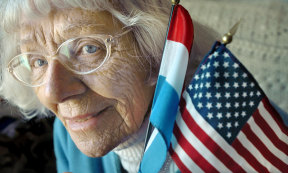 Diet Eman poses for a photograph in 2007 at her home in Grand Rapids, Michigan, before becoming a US citizen at the age of 86.