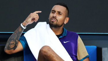 Nick Kyrgios argues with the chair umpire after receiving a time violation.