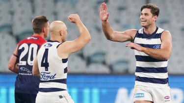Top Cat: Geelong forward Tom Hawkins celebrates a major during the round 4 win over Melbourne at the MCG.