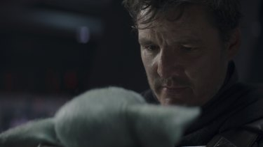 Mando (Pedro Pascal) and Grogu say goodbye in the tearful season finale of The Mandalorian.