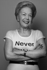 Susan Alberti, Australia's first female registered builder (wearing a T-shirt emblazoned with 'Never give up'), is throwing her clout behind a push to get more girls to consider trades.