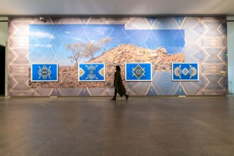 Kent Morris' Barkindji Blue Sky-Ancestral Connections #11, 2021, digital print on phototex wallpaper, with framed giclee prints on rag paper, 492x1356cm, at TarraWarra Museum of Art, part of the Wilam Biik exhibition. Courtesy of the artist and Vivian Anderson Gallery.