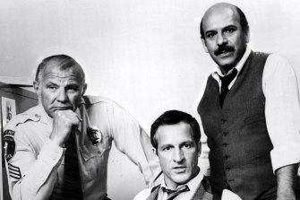 Michael Conrad as Sgt. Phillip Esterhaus, Daniel J. Travanti as Capt. Frank Furillo and Rene Enriquez as Lt. Roy Calletano in Hill Street Blues.