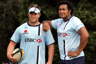 Dan Palmer, pictured with Sekope Kepu in 2007, took up a deal with the Waratahs straight out of high school.