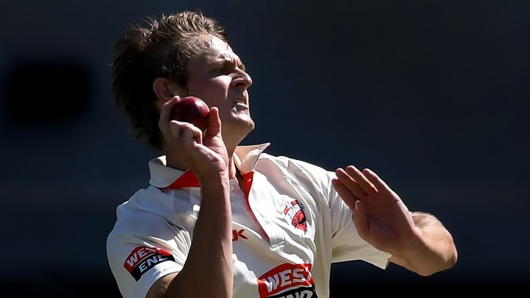 Paceman Joe Mennie has been hit twice while bowling.