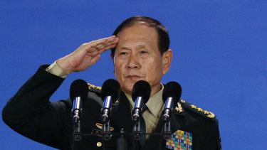 Chinese Defence Minister salutes after delivering his speech at the Xiangshan Forum.