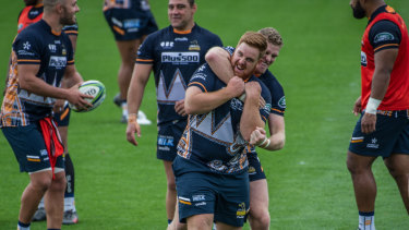 Tom Ross, front, and Tom Cusack are two of seven Canberra players in the Brumbies' side this week. Ross will make his Super Rugby debut as a 20-year-old on Friday night.