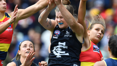 Erin Phillips of the Adelaide Crows and Brianna Davey of the Blues contest the ball  during the AFLW Grand Final match.