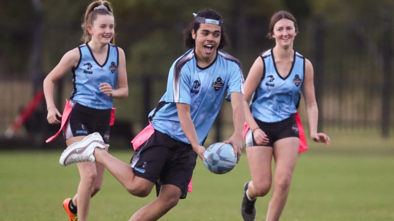 Juniors playing Oztag, a version of rugby league with velcro patches instead of tackling.