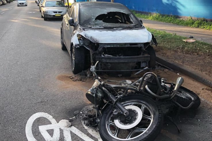 The man is accused of setting fire to a motorbike, before the flames spread to a nearby car.